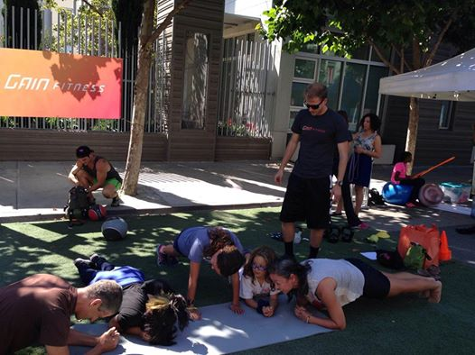 Chris leading a GAIN Fitness bootcamp at Sunday Streets in the Mission